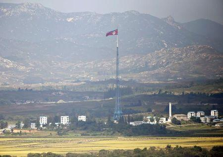 A North Korean flag is seen on top of a tower near the truce village of Panmunjom in the DMZ