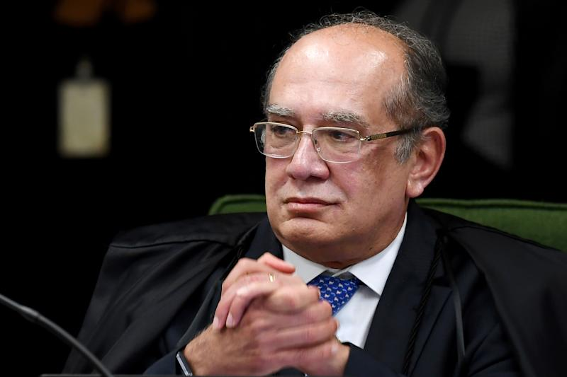 """Brazilian Supreme Court judge Gilmar Mendes attends the trial of senator and Workers' Party president Gleisi Hoffmann for corruption and money laundering, at the Supreme Court in Brasilia, on June 19, 2018. - Hoffmann is the latest in a long string of high-ranking politicians, including many from the Workers' Party, caught up in Brazil's sprawling """"Car Wash"""" corruption probe. Prosecutors accuse Hoffmann and husband Paulo Bernardo, a former planning and communications minister, of receiving a million reais in 2010, or 568,000 US dollars at the time, embezzled from state-oil company Petrobras. The money from the company was allegedly used in a campaign slush fund. (Photo by EVARISTO SA / AFP) (Photo credit should read EVARISTO SA/AFP via Getty Images)"""