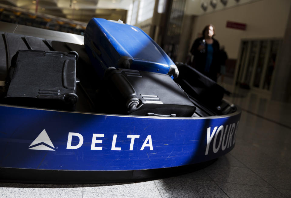 FILE- In this Jan. 30, 2017, file photo, bags sit on a belt at Delta Air Lines baggage claim in Hartsfield-Jackson Atlanta International Airport in Atlanta. Georgia lawmakers punished Atlanta-based Delta Air Lines on Thursday, March 1, 2018, for its decision to cut business ties with the National Rifle Association in the wake of a shooting at a Florida high school that killed over a dozen people. A tax measure, which was stripped of a jet-fuel tax break, passed the GOP-dominated Senate 44-10. (AP Photo/David Goldman, File)