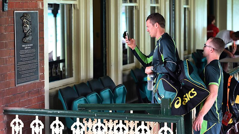 Peter Siddle, pictured here inspecting a plaque remembering the late Phillip Hughes at the SCG in 2015.
