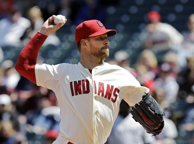 Cleveland Indians starting pitcher Corey Kluber delivers against the Chicago White Sox in the first inning of a baseball game on Sunday, May 4, 2014, in Cleveland. (AP Photo/Mark Duncan)