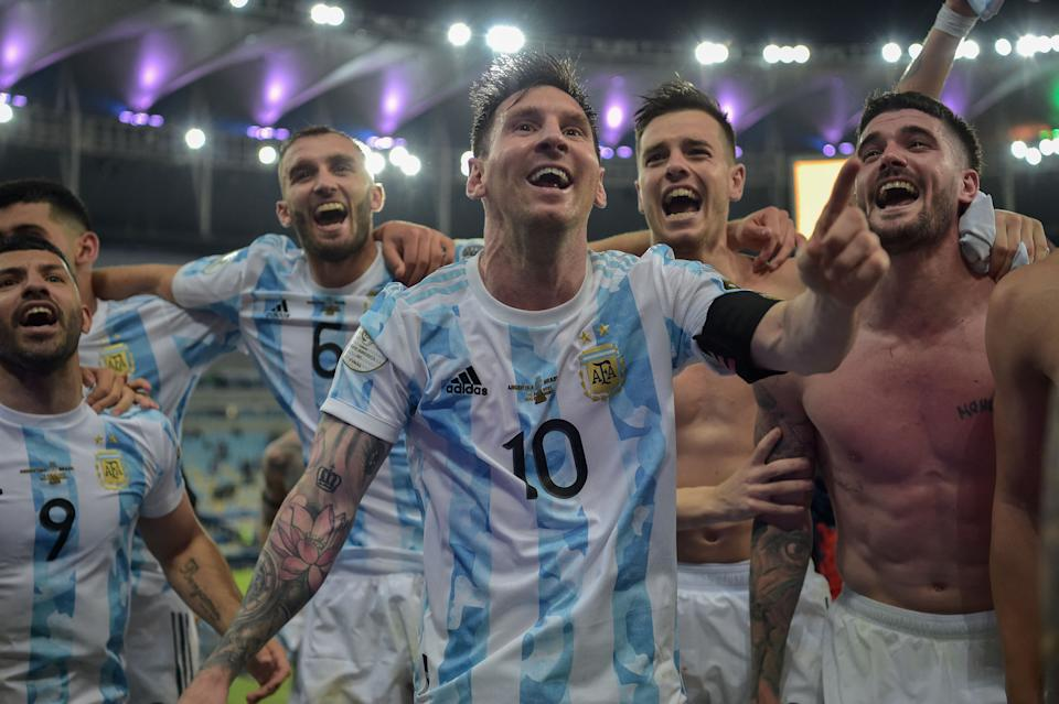 Argentina's Lionel Messi (C) and teammates celebrate after winning the Conmebol 2021 Copa America football tournament final match against Brazil at Maracana Stadium in Rio de Janeiro, Brazil, on July 10, 2021. - Argentina won 1-0. (Photo by CARL DE SOUZA / AFP) (Photo by CARL DE SOUZA/AFP via Getty Images)