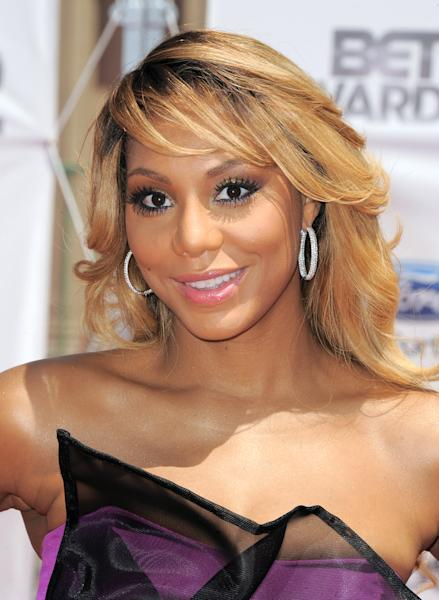 "FILE - This July 1, 2012 file photo shows Tamar Braxton at the BET Awards in Los Angeles. Braxton is nominated for three honors at Sunday's Grammy Awards, including best urban contemporary album for her first album in 13 years, ""Love and War."" The title track is also nominated for best R&B song and R&B performance. (Photo by Jordan Strauss/Invision/AP, File)"