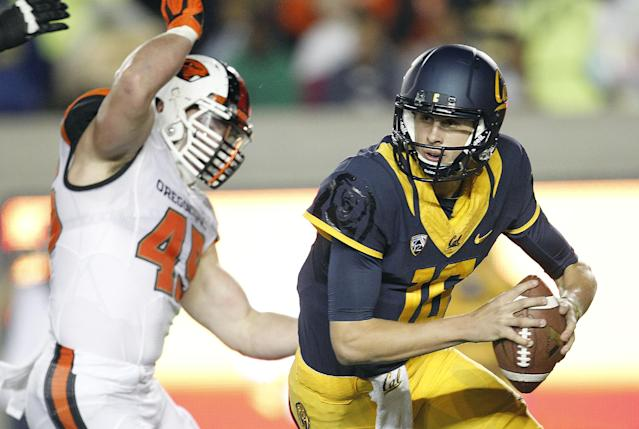 California quarterback Jared Goff (16) scrambles out of the pocket from Oregon State defensive end Dylan Wynn (45) during the first quarter of an NCAA college football game in Berkeley, Calif., Saturday, Oct. 19, 2013. (AP Photo/Tony Avelar)