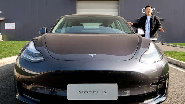 PHOTO: A staff member explains the China-made Tesla Model 3 vehicle at the Shanghai Gigafactory of the U.S. electric car maker in Shanghai, China, Dec. 30, 2019. (Sun Yilei/Reuters)
