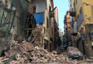 A general view shows the damage along a street following a blast in Beirut's port area