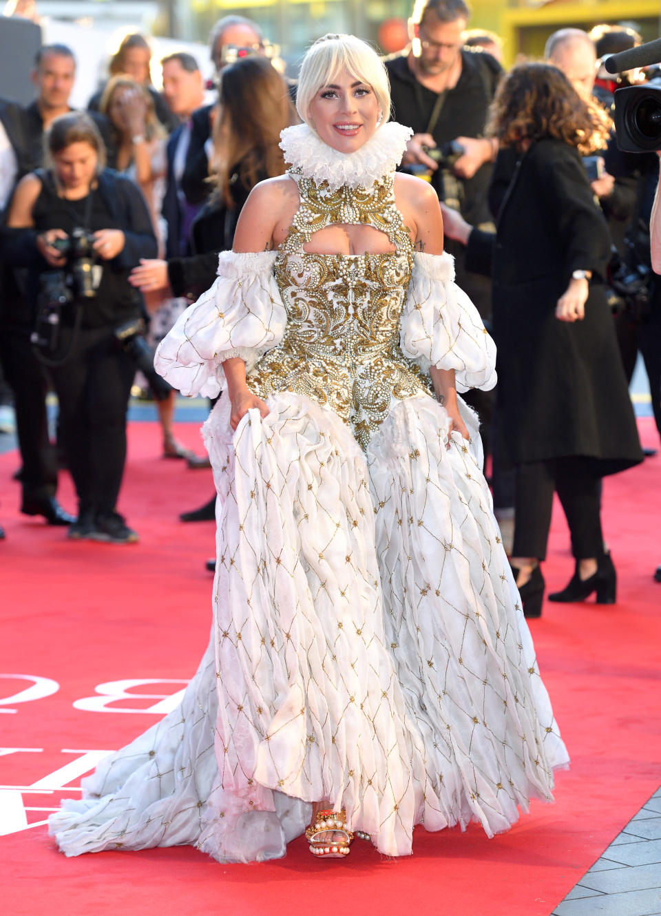 <p>Lady Gaga is globally renowned for her quirky sense of style so it came as no surprise to see her don Shakesperean ruffles by Alexander McQueen for the UK premiere of 'A Star Is Born'. <em>[Photo: Getty]</em> </p>