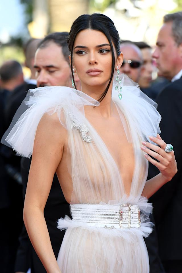 "<p>This daring dress definitely stole the spotlight on the Cannes red carpet, but we're also seriously loving this '90s-inspired look. The straight tendrils framing her face and plumped brown nude lip are giving us Spice Girl-era <a class=""sugar-inline-link ga-track"" title=""Latest photos and news for Victoria Beckham"" href=""https://www.popsugar.co.uk/Victoria-Beckham"" target=""_blank"" data-ga-category=""Related"" data-ga-label=""https://www.popsugar.co.uk/Victoria-Beckham"" data-ga-action=""&lt;-related-&gt; Links"">Victoria Beckham</a> vibes.</p>"