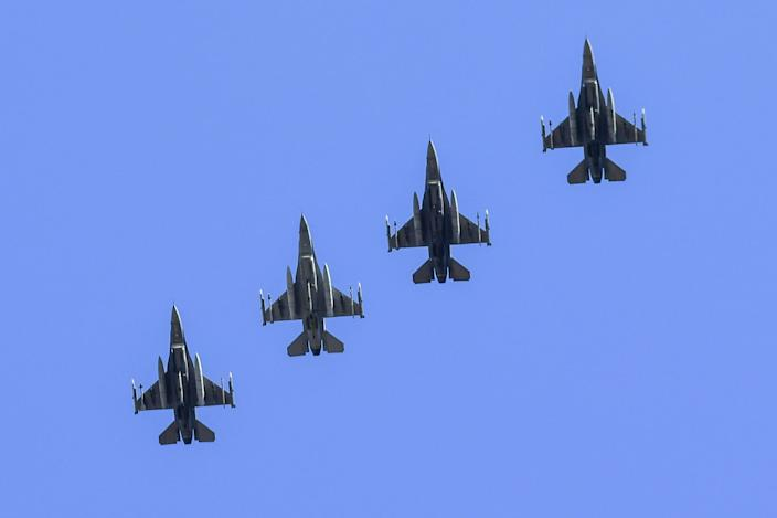 Four military F-16 planes from the 169th Fighter Wing, 157th Fighter Squadron, South Carolina National Air Guard, based in McEntire Joint National Guard Base, fly before a Clemson game.