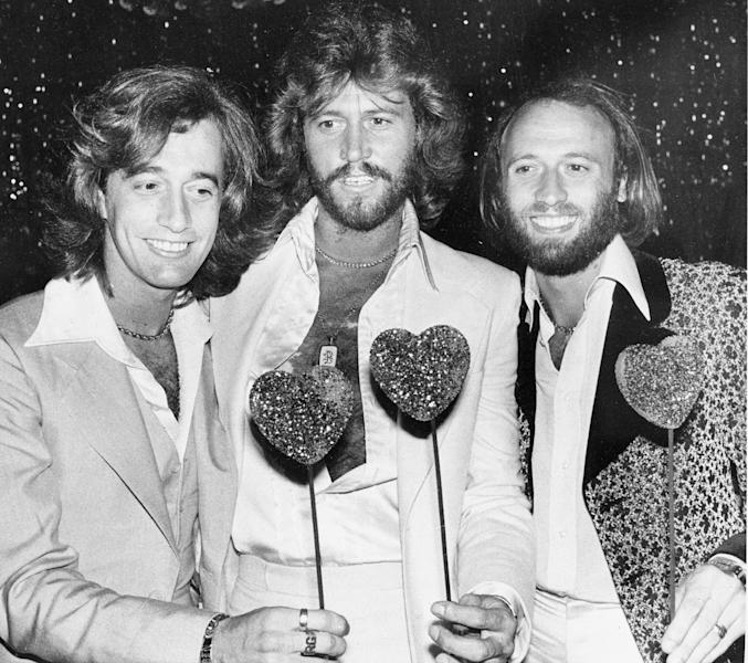In this July 31, 1978, file photo, the British pop group the Bee Gees, from left, Robin Gibb, Barry Gibb and Maurice Gibb, pose for photographers, in Los Angeles. A representative said on Sunday, May 20, 2012, that Robin Gibb has died. He was 62. (AP Photo/Lennox Mclendon, File)