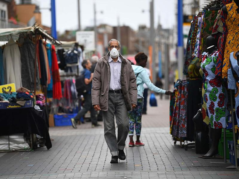 Stalls reopen at Walthamstow Market in east London, the longest street market in Europe, following the introduction of measures to bring England out of lockdown, 3 June 2020: Victoria Jones/PA