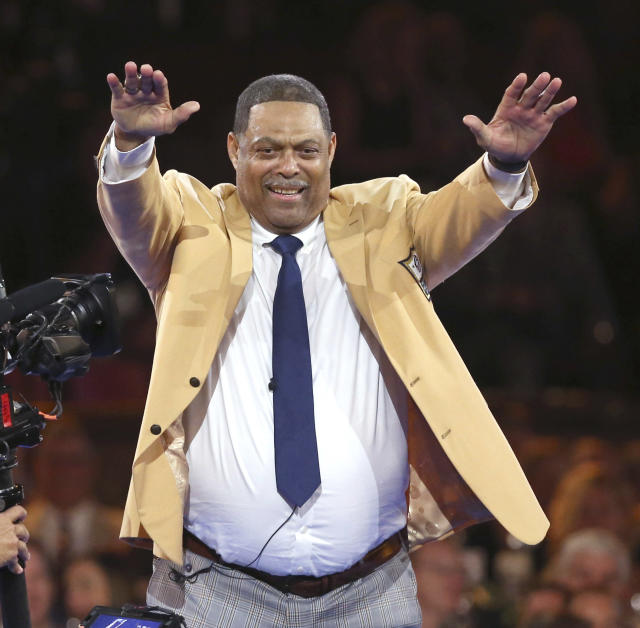 Robert Brazile reacts to the crowd after receiving his gold jacket during the Pro Football Hall of Fame Gold Jacket Dinner on Friday night. (AP)