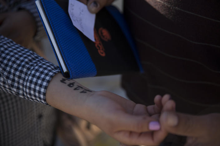 A woman from southern Mexico holds out her arm where administrators at Casa del Migrante wrote a number on her arm to hold her place in a growing list of asylum seekers in Juarez, Mexico, on Nov. 29, 2018. (Photo: Adria Malcolm for Yahoo News)