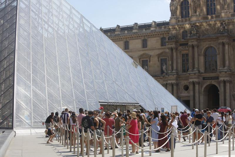 Tourists waiting in line in front the Louvre Museum on Monday (local time).