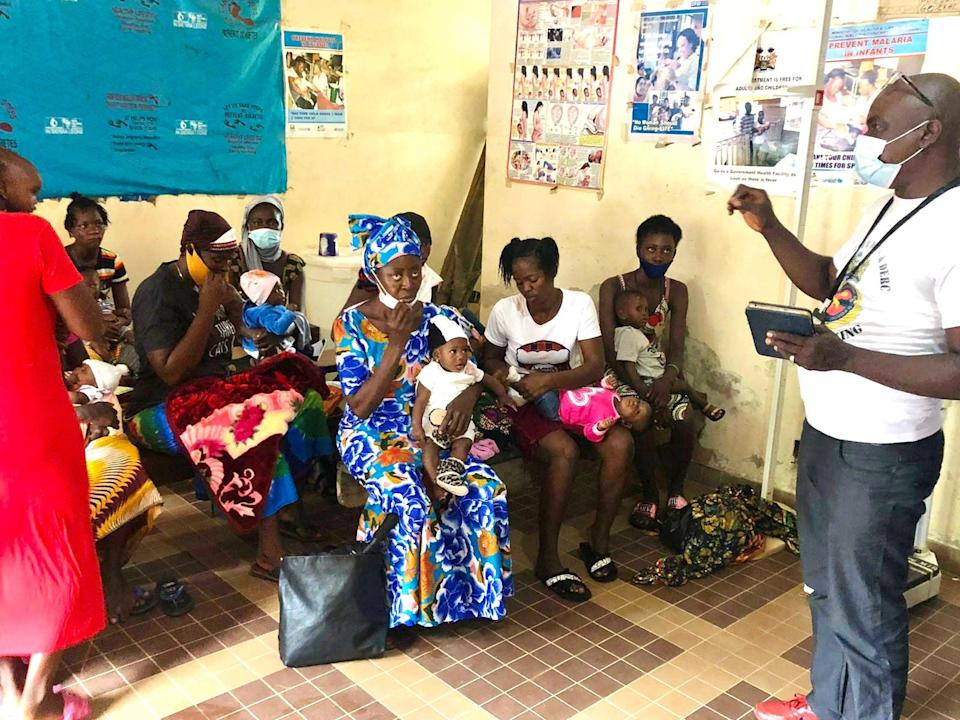 Mothers waiting to be vaccinated at Benguema Community Health Centre, Sierra Leone (UNICEF)