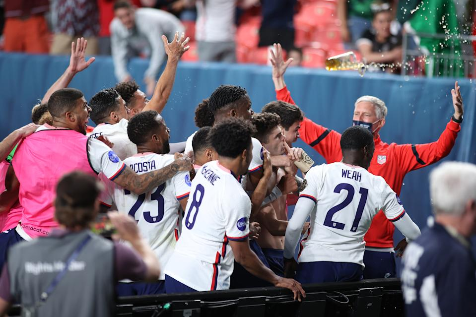 DENVER, CO - JUNE 06: United States forward Christian Pulisic (10) celebrates with teammates after scoring a goal from a penalty kick in extra time action during the CONCACAF Nations League finals between Mexico and the United States on June 06, 2021, at Empower Field at Mile High in Denver, CO. (Photo by Robin Alam/Icon Sportswire via Getty Images)
