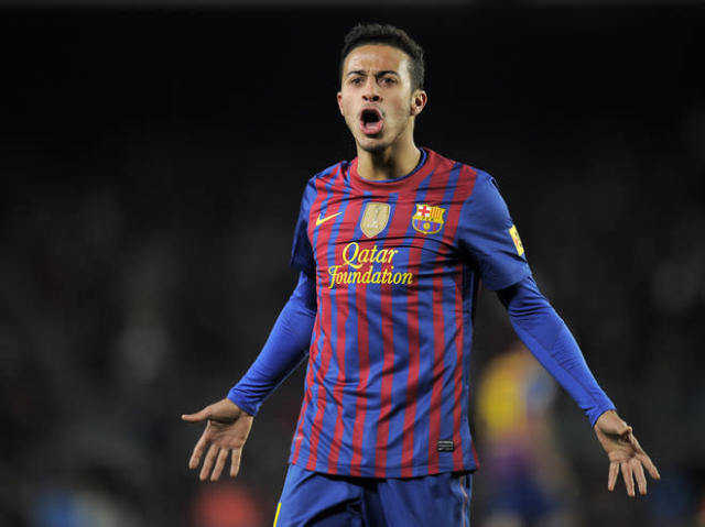 Barcelona's midfielder Thiago Alcántara reacts during the Spanish Cup second leg semi-final football match FC Barcelona vs Valencia CF on February 8, 2012 at the Camp Nou stadium in Barcelona. AFP PHOTO / LLUIS GENE