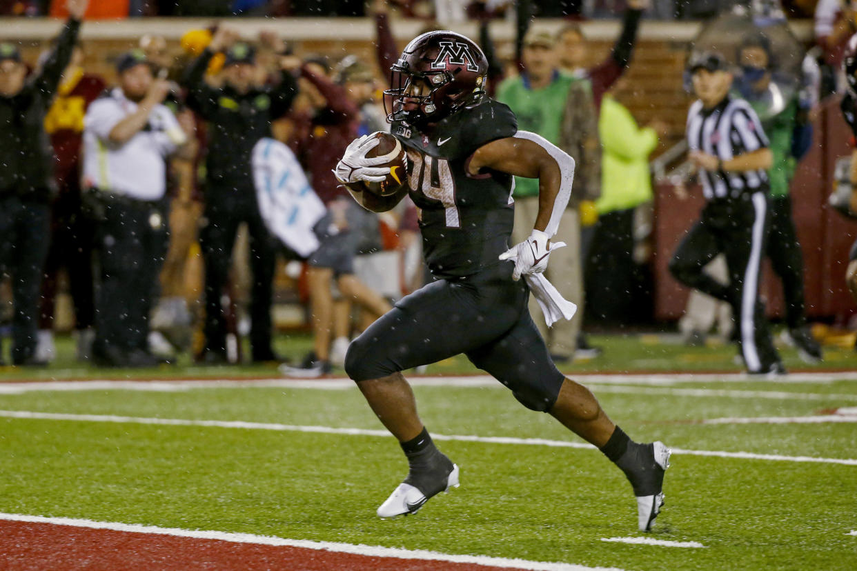 Minnesota running back Mohamed Ibrahim rushes for a touchdown against Ohio State during the third quarter of an NCAA college football game Thursday, Sept. 2, 2021, in Minneapolis. Ohio State won 45-31. (AP Photo/Bruce Kluckhohn)