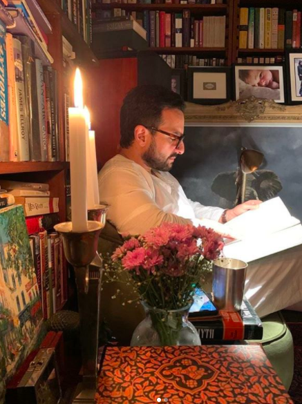 Saif Ali Khan catches up on some reading in his study.