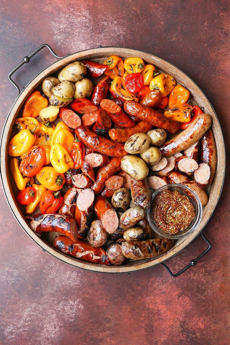 """<p>In need of a dish that does double duty as breakfast and dinner? This does the trick.</p><p><strong>Get the recipe at <a href=""""https://damndelicious.net/2018/09/05/grilled-sausages-peppers-and-potatoes/"""" rel=""""nofollow noopener"""" target=""""_blank"""" data-ylk=""""slk:Damn Delicious"""" class=""""link rapid-noclick-resp"""">Damn Delicious</a>.</strong></p><p><strong><strong><strong><strong><strong><a class=""""link rapid-noclick-resp"""" href=""""https://go.redirectingat.com?id=74968X1596630&url=https%3A%2F%2Fwww.walmart.com%2Fip%2FPioneer-Woman-Slotted-Turner%2F910200136&sref=https%3A%2F%2Fwww.thepioneerwoman.com%2Ffood-cooking%2Fmeals-menus%2Fg32188535%2Fbest-grilling-recipes%2F"""" rel=""""nofollow noopener"""" target=""""_blank"""" data-ylk=""""slk:SHOP KITCHEN TOOLS"""">SHOP KITCHEN TOOLS</a></strong></strong></strong></strong><br></strong></p>"""