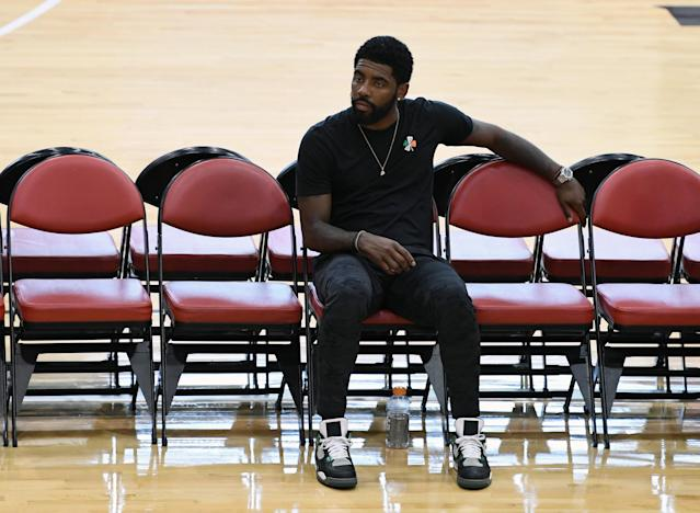 "<a class=""link rapid-noclick-resp"" href=""/nba/players/4840/"" data-ylk=""slk:Kyrie Irving"">Kyrie Irving</a>, while at the USA men's national team practice in Las Vegas on Thursday, went into detail about recovering from his knee injury over the past several months, describing it as a ""long [expletive] few months."" (Getty Images)"