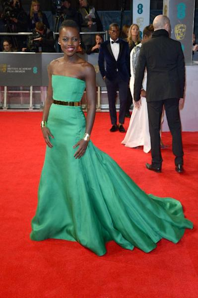 Kenyan actress Lupita Nyong'o poses for photographers on the red carpet at the EE British Academy Film Awards held at the Royal Opera House on Sunday Feb. 16, 2014, in London. (photos by Jon Furniss/Invision/AP)