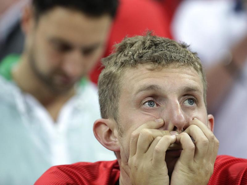 England fans react following Uruguay's 2-1 victory over England in the group D World Cup soccer match between Uruguay and England at the Itaquerao Stadium in Sao Paulo, Brazil, Thursday, June 19, 2014