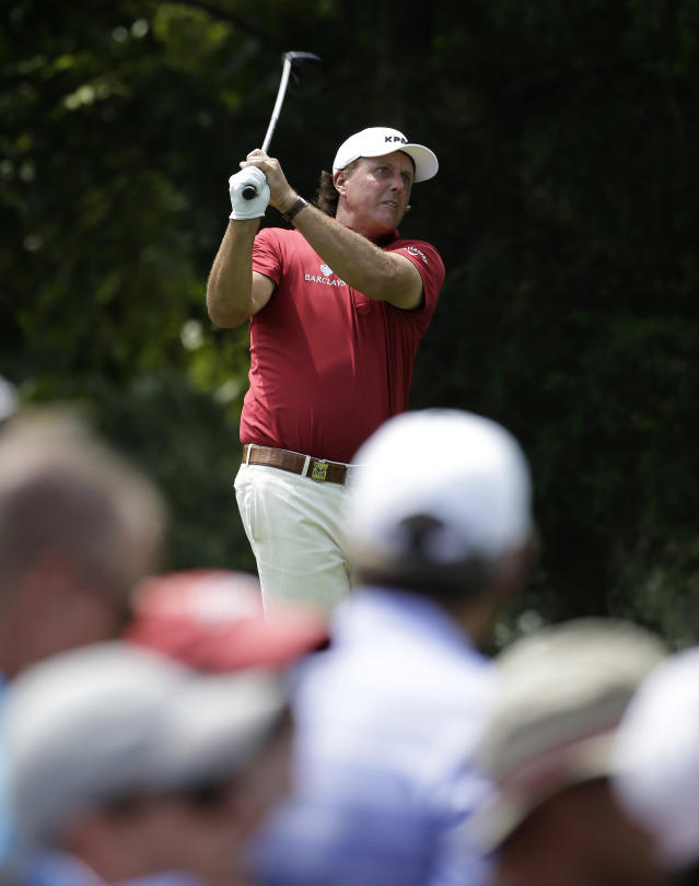 Phil Mickelson hits his tee shot on the 18th hole during a practice round for the PGA Championship golf tournament at Valhalla Golf Club on Tuesday, Aug. 5, 2014, in Louisville, Ky. The tournament is set to begin on Thursday. (AP Photo/David J. Phillip)