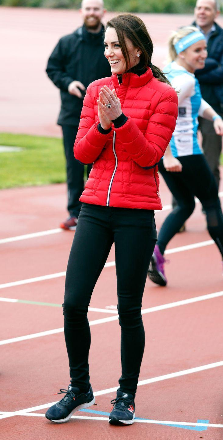 <p>Kate Middleton wears a bright red puffer jacket, black athletic leggings and New Balance sneakers at a Team Heads Together marathon with Prince William and Prince Harry in London. </p>