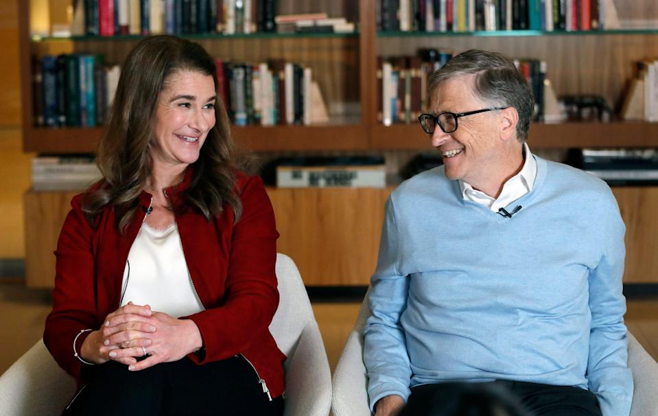 In this Feb. 1, 2019, file photo, Bill and Melinda Gates smile at each other during an interview in Kirkland, Wash.
