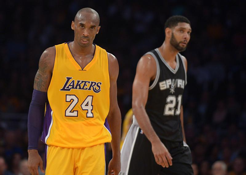 Nov 14, 2014; Los Angeles, CA, USA; Los Angeles Lakers guard Kobe Bryant (24) and San Antonio Spurs forward Tim Duncan (21) react at Staples Center. The Spurs defeated the Lakers 93-80. Mandatory Credit: Kirby Lee-USA TODAY Sports