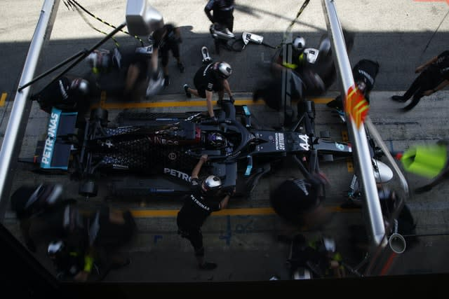 Lewis Hamilton, pictured after stopping in the pits in Barcelona (AP)