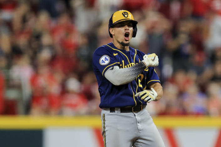 Milwaukee Brewers' Willy Adames yells at second base after hitting an RBI single during the seventh inning of the team's baseball game against the Cincinnati Reds in Cincinnati, Saturday, July 17, 2021. Willy Adames advanced to second base on the throw to home plate. (AP Photo/Aaron Doster)