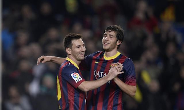 FC Barcelona's Lionel Messi, from Argentina, left, reacts after scoring with his teammate Sergio Roberto against Getafe during a Copa del Rey soccer match at the Camp Nou stadium in Barcelona, Spain, Wednesday, Jan. 8, 2014. (AP Photo/Manu Fernandez)