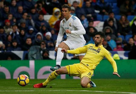 Soccer Football - La Liga Santander - Real Madrid vs Villarreal - Santiago Bernabeu, Madrid, Spain - January 13, 2018 Real Madrid's Cristiano Ronaldo shoots at goal as Villarreal's Alvaro Gonzalez challenges REUTERS/Javier Barbancho
