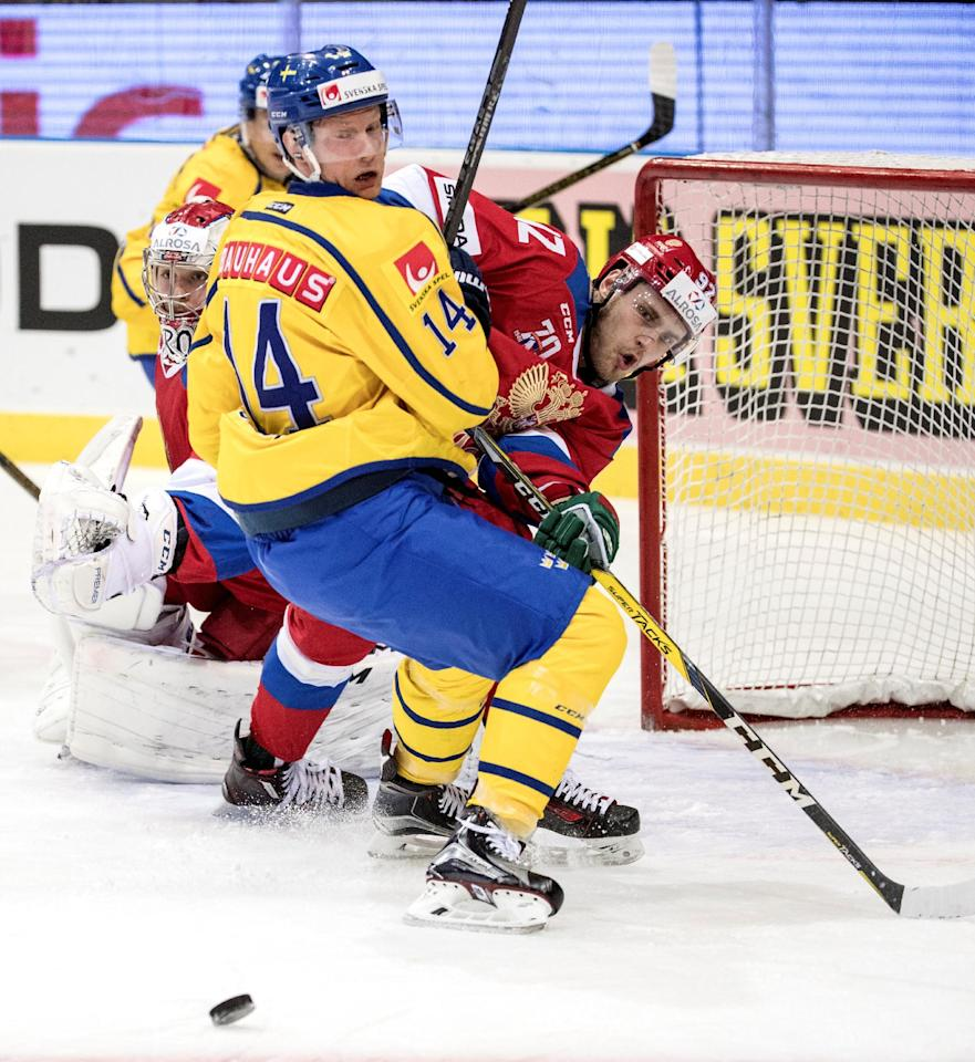 Sweden's Richard Gynge is stopped by Russia's Zakhar Arzamastsev during the ice hockey match between Sweden and Russia at the Sweden Hockey Games in Scandinavium Arena in Goteborg, Sweden February 11, 2017.  TT News Agency/Bjorn Larsson Rosvall/via REUTERS  ATTENTION EDITORS - THIS IMAGE WAS PROVIDED BY A THIRD PARTY. FOR EDITORIAL USE ONLY. SWEDEN OUT. NO COMMERCIAL OR EDITORIAL SALES IN SWEDEN.