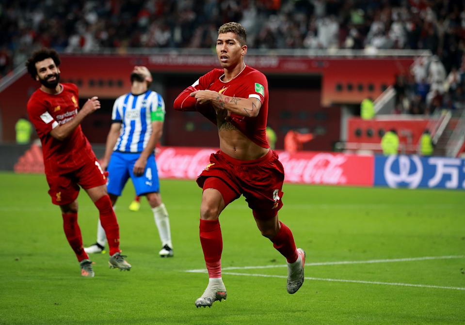 Liverpool's Roberto Firmino celebrates scoring his side's second goal of the game during the FIFA Club World Cup semi final match at the Khalifa International Stadium, Doha. (Photo by Adam Davy/PA Images via Getty Images)