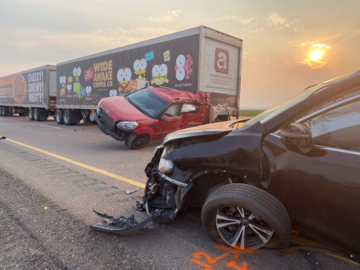 This photo provided by the Utah Highway Patrol and posted on the Utah Department of Public Safety website shows several of the vehicles involved in a fatal pileup on Sunday, July 25, 2021, on Interstate 15 in Millard County, near the town of Kanosh, Utah. / Credit: AP