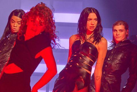 """<p>Always ahead of the curve, Dua Lipa wore a leather, palm leaf mini dress from Dion Lee's next collection for her Los 40 Awards performance. While her exact fashion-meets-Flintstone dress isn't available quite yet, so many of the Australian designer's pieces are worth investing in.</p><p><a class=""""link rapid-noclick-resp"""" href=""""https://go.redirectingat.com?id=127X1599956&url=https%3A%2F%2Fwww.net-a-porter.com%2Fen-gb%2Fshop%2Fdesigner%2Fdion-lee&sref=https%3A%2F%2Fwww.elle.com%2Fuk%2Ffashion%2Fcelebrity-style%2Fg19613955%2Fdua-lipas-style-file%2F"""" rel=""""nofollow noopener"""" target=""""_blank"""" data-ylk=""""slk:SHOP DION LEE NOW"""">SHOP DION LEE NOW</a></p><p><a href=""""https://www.instagram.com/p/CIdkReisyKo/"""" rel=""""nofollow noopener"""" target=""""_blank"""" data-ylk=""""slk:See the original post on Instagram"""" class=""""link rapid-noclick-resp"""">See the original post on Instagram</a></p>"""