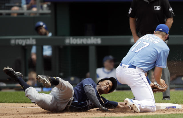 Tampa Bay Rays' Mallex Smith, left, dives back to the bag ahead of the attempted pick off tag by Kansas City Royals first baseman Hunter Dozier (17) during the fourth inning of a baseball game at Kauffman Stadium in Kansas City, Mo., Wednesday, May 16, 2018. (AP Photo/Orlin Wagner)