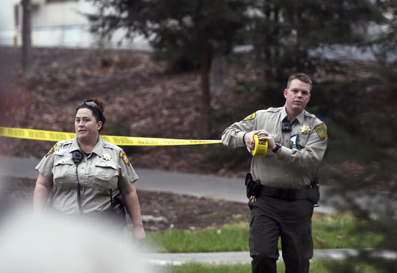 Public Safety officers put up caution tape around building G the morning after a hostage situation at the Veterans Home of California in Yountville, Calif., on Saturday, March 10, 2018. A daylong siege at The Pathway Home ended Friday evening with the discovery of four bodies, including the gunman, identified as Albert Wong, a former Army rifleman who served a year in Afghanistan in 2011-2012. (AP Photo/Josh Edelson)