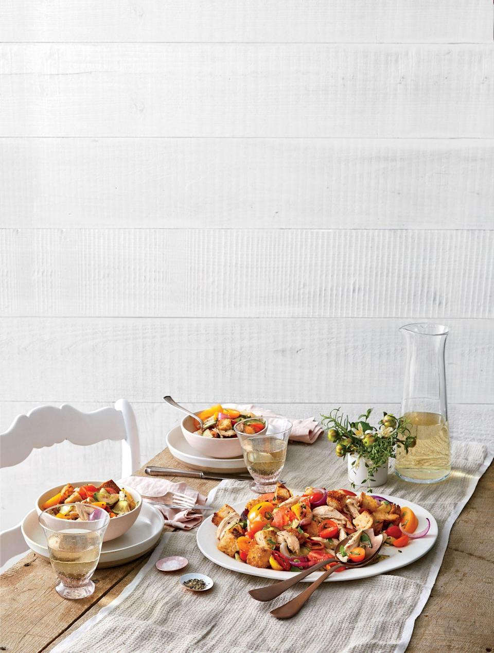 """<p><strong>Recipe: </strong><a href=""""https://www.southernliving.com/recipes/whole-grain-panzanella-recipe"""" rel=""""nofollow noopener"""" target=""""_blank"""" data-ylk=""""slk:Whole-Grain Panzanella"""" class=""""link rapid-noclick-resp""""><strong>Whole-Grain Panzanella</strong></a></p> <p>Shredded rotisserie chicken from the grocery store is an easy way to add extra protein to this juicy tomato panzanella.</p>"""