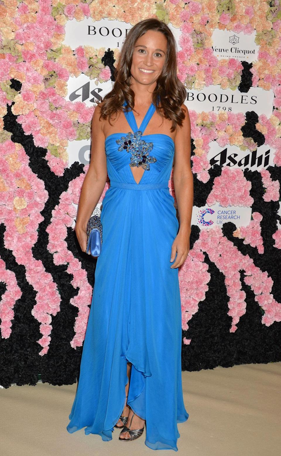 <p>Wearing a tiered Jenny Packham dress, boasting a keyhole design, Pippa looked bronzed and beautiful at a ball in September 2015. <i>[Photo: Rex]</i> </p>