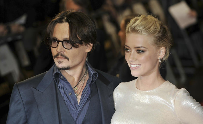 """Photo by: KGC-138/STAR MAX/IPx 2019 11/3/11 Johnny Depp and Amber Heard at the premiere of """"The Rum Diary"""". (London, England)"""