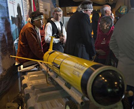 John Disney (2nd L), director of Old Massett Village economic development on Haida Gwaii, looks at the underwater probe used during their ocean fertilization project at a news conference in Vancouver, British Columbia, in this October 19, 2012 file picture. REUTERS/Andy Clark