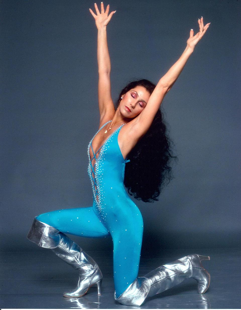 <p>Cher incorporated a jumpsuit into this vibrant look in 1978. (Photo: Harry Langdon/Getty Images) </p>