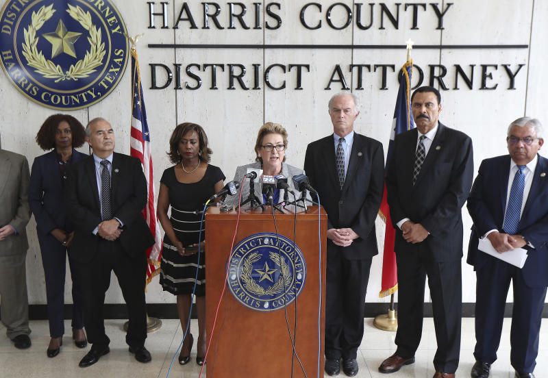 Harris County District Attorney Kim K. Ogg announces that her office has charged two officers in the Harding Street Raid Friday, Aug. 23, 2019, in Houston. A former Houston police officer has been charged with murder in connection with the deadly January drug raid of a home that killed a couple who lived there and injured five officers, prosecutors announced Friday.  ( Steve Gonzales/Houston Chronicle via AP)