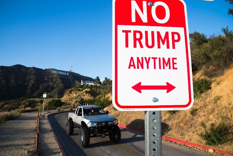 "A sign reading ""No Trump Anytime"" on April 27, 2016 in the hills above Hollywood, California (AFP Photo/Robyn Beck)"