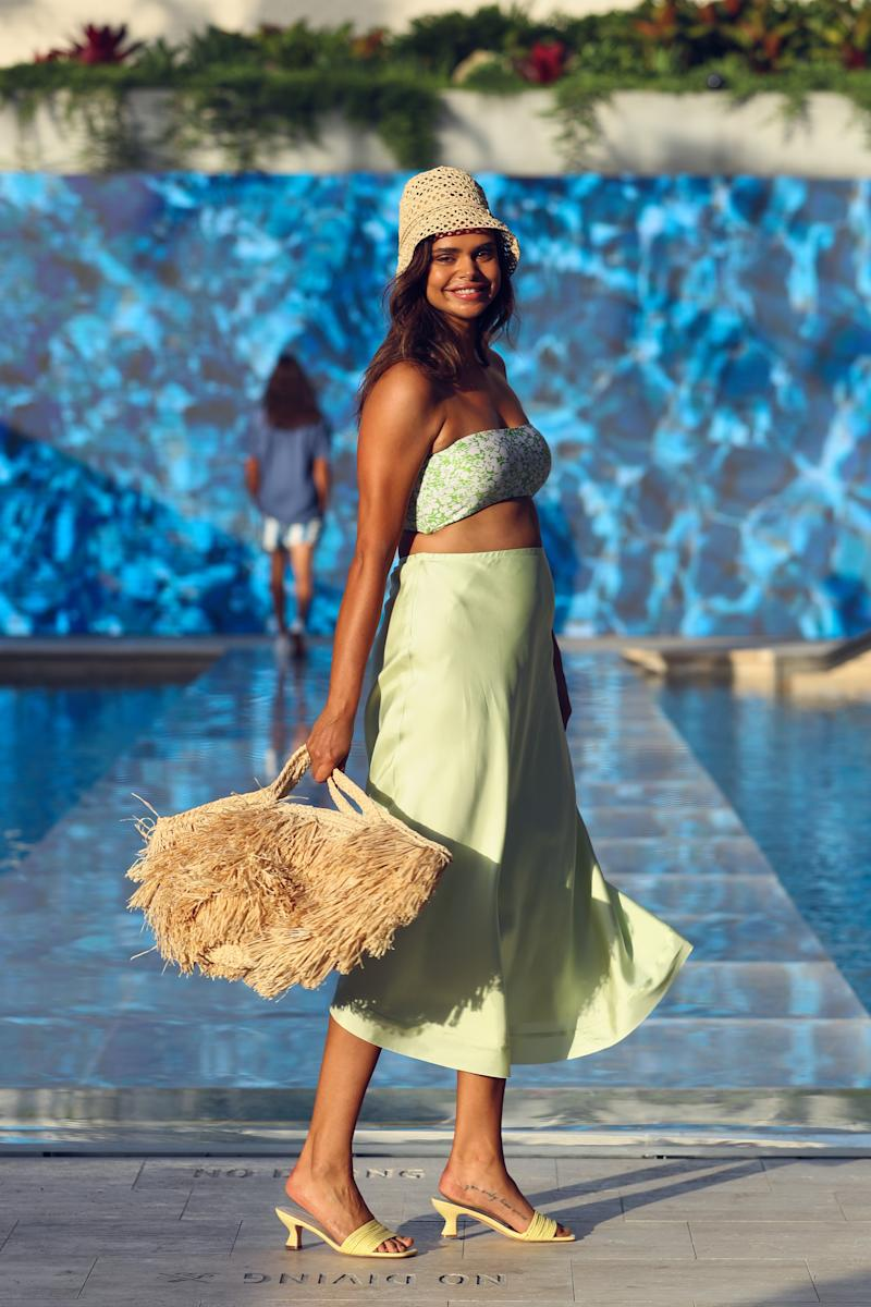 Model Samantha Harris wears the Faithfull Grete Bikini (sold as a set $189), Maggie Marilyn Feeling Fruity Skirt, $580 and the Sans Arcidet Paris Aliba Bag Large, $210 from THE ICONIC Summer Show '19.