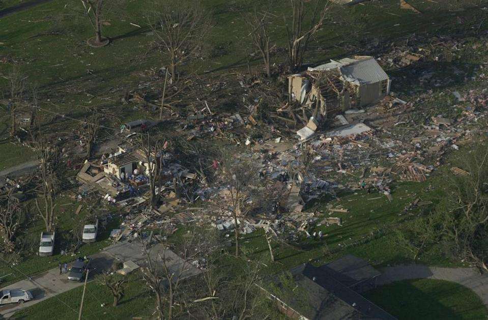 This Kansas City, Kan. house and outbuilding were in the path of one of tornados on May 4, 2003. It is east of Wyandotte County Park near Leavenworth Road.